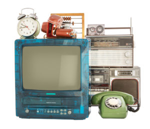 Old household items: TV, VCR, radio, camera, alarm, phone, recorder, abacus. Old household items isolated on white background.
